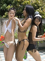 Three seductive asian babes showing their boobies in the backyard
