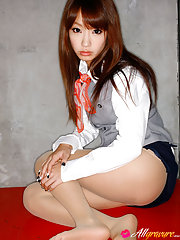 Seductive asian stewardess slowly takes off her uniform